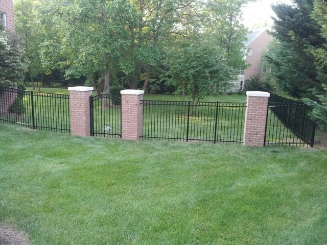 Residential aluminum fence in backyard