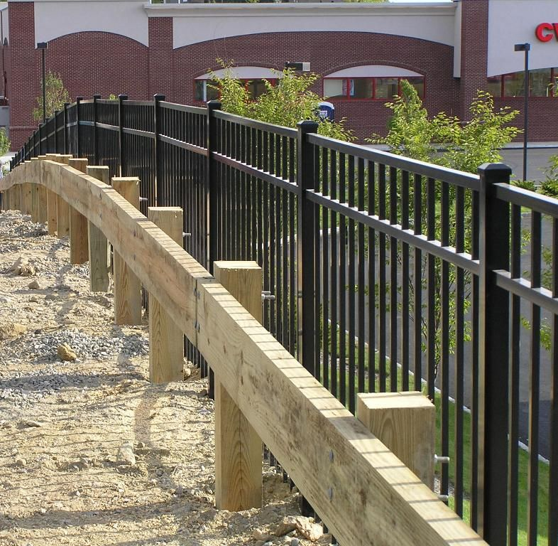 Wooden Guard Rail with a commercial aluminum fence