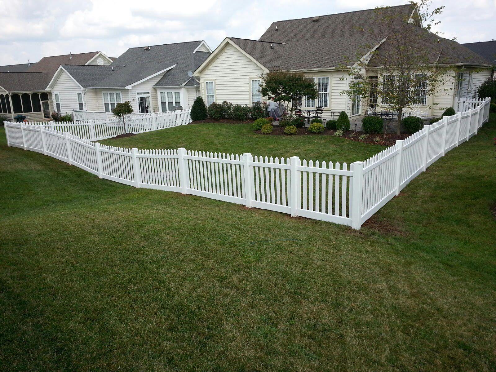 white vinyl fence around backyard